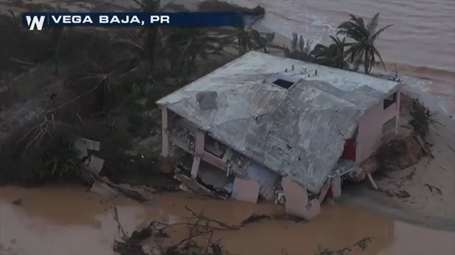 Aerial view of a building in Vega Baja, Puerto Rico, that was destroyed by Hurricane Maria. Photo: AP / USA TODAY