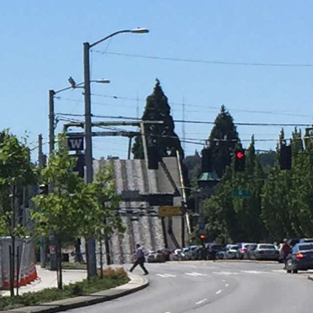 The Montlake Bridge is up to let boats pass through the cut.
