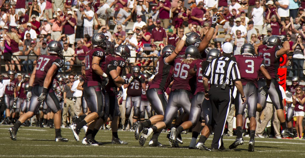 Defense celebrates after forcing a fumble late in the game.  Dan Moore would score shortly after.  Washington - Grizzly Stadium, Montana Grizzlies vs. South Dakota Coyotes.  Missoula, MT, September 1st, 2012.