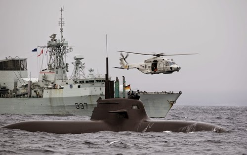 The German submarine U33 HMCS Fredericton of Canada and a helicopter of Netherlands participates in NATOs Dynamic Mongoose antisubmarine exercise in the North Sea off the coast of Norway May 4 2015 NATO launched one of its biggestever antisubmarine exercises in the North Sea on Monday inviting nonmember Sweden for the first time amid increasing tensions between Russia and its northern neighbors More than a dozen vessels from 11 countries are participating in the