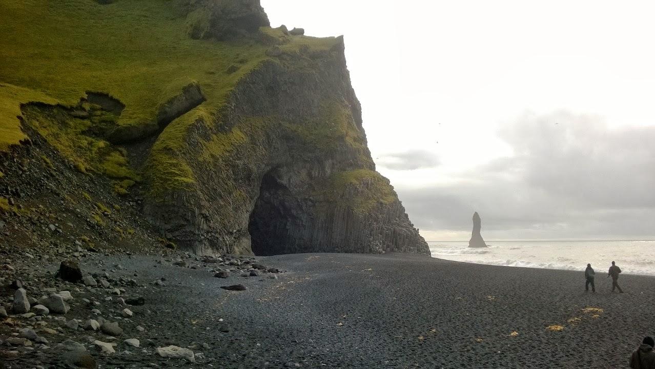 Big cave in cliff on Reynishverfi beach.
