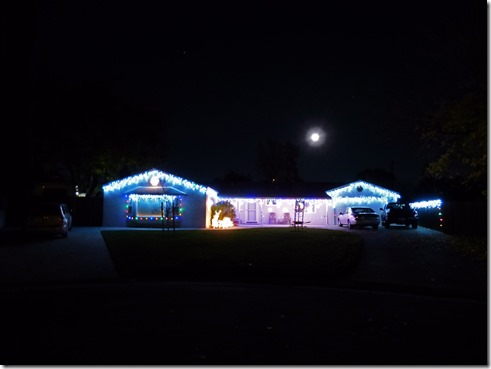 Sister's House dressed up for Christmas with Super Moon over House