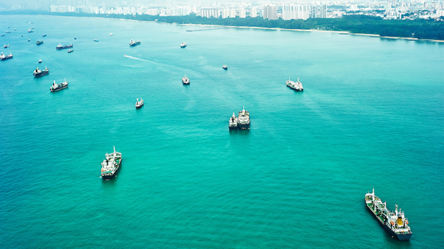 Ships wait off the harbour in Singapore. Photo: Deposit Photos