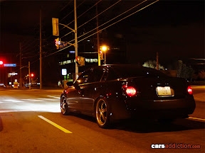 Nissan Maxima at the lights