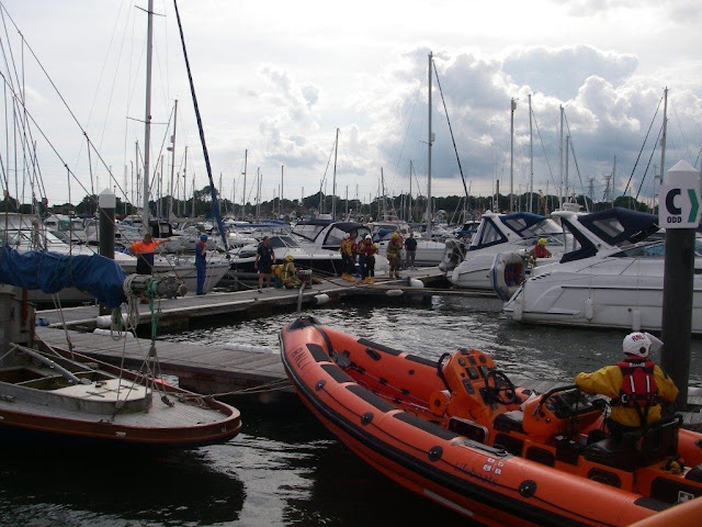21 July 2012 - Poole ILB at the scene of a fire onboard a motor cruiser with the Fire Service in attendance. Photo: RNLI/Poole