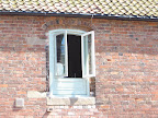 Flush casement window with 3 centred arched head