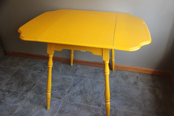 Yellow farmhouse table from the rental inventory of www.momentarilyyours.com, $25.00.