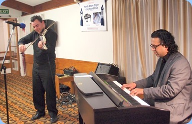 Our guest artists, Nick Jones (electric fiddle) and Ben Fernandez (Clavinova). Photo courtesy of Dennis Lyons.