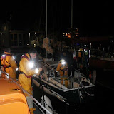 Poole all-weather lifeboat escorting an 8m yacht to Poole Quay Boat Haven with one lifeboat crew member onboard after the yacht had grounded on Hook Sands - 1 May 2014 Photo: RNLI Poole