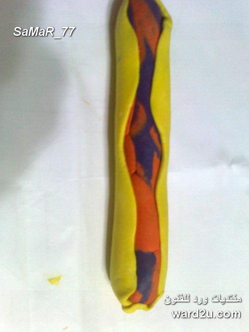 طبق السفرة سعيد بإمتزاج ألوان عجينة السيراميك