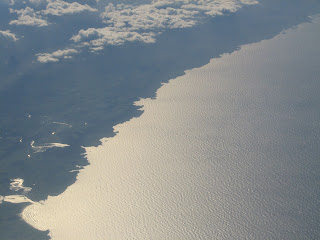 Aerial - sunglint on the northern Spanish coastline near Bilbao