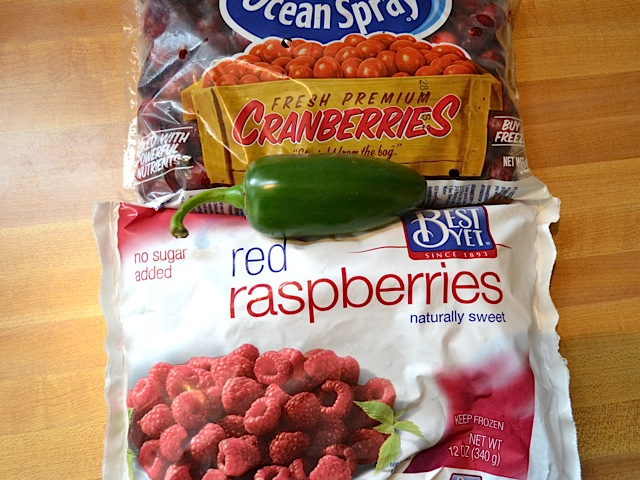 bag of cranberries and bag of raspberries with one whole jalapeno