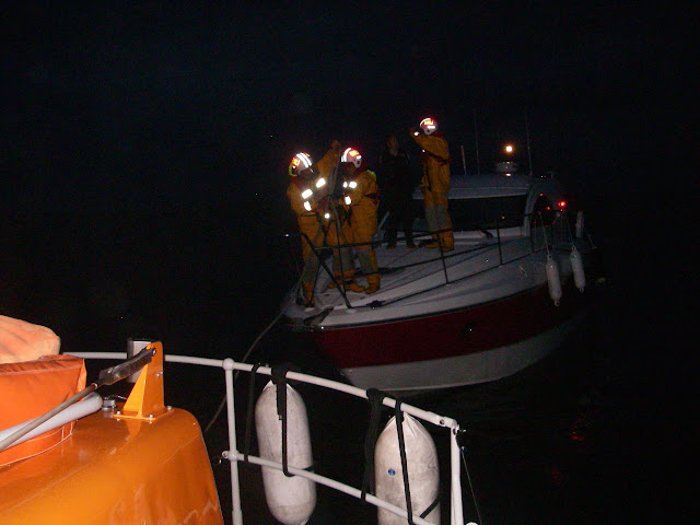 15 August 2011 - Poole lifeboat taking over a tow from Swanage lifeboat of a motorboat with engine failure. (Photo: Paul Taylor)