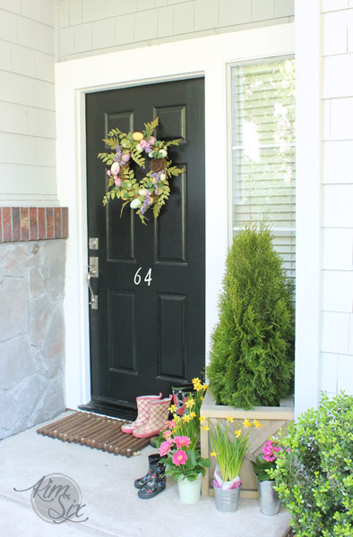 Spring front porch with wooden doormat