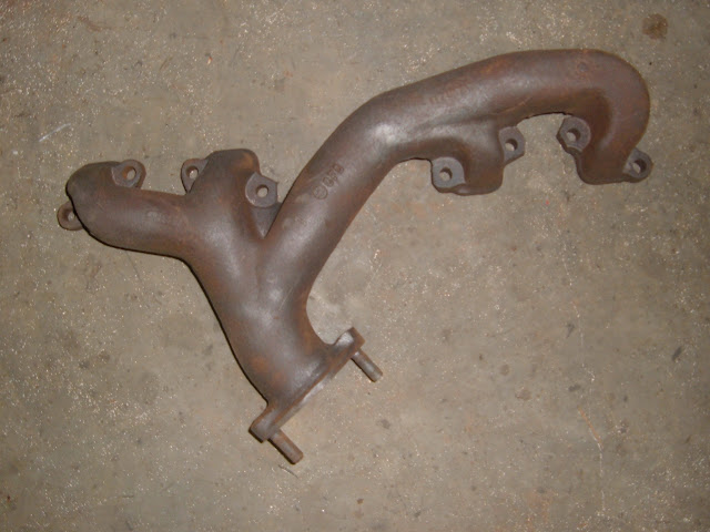 1957-1958 left dual exhaust manifold. Contact us