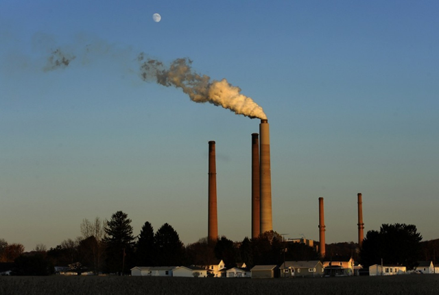 The American Electric Power coal burning plant in Conesville, Ohio, had a scrubber (a filtering system to limit emissions into the air) added to the unit seen emitting smoke in this photo. Photo: Michael Williamson / The Washington Post