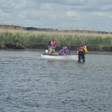 A crew member attaches tow rope to the front of the boat - 14 May 2014