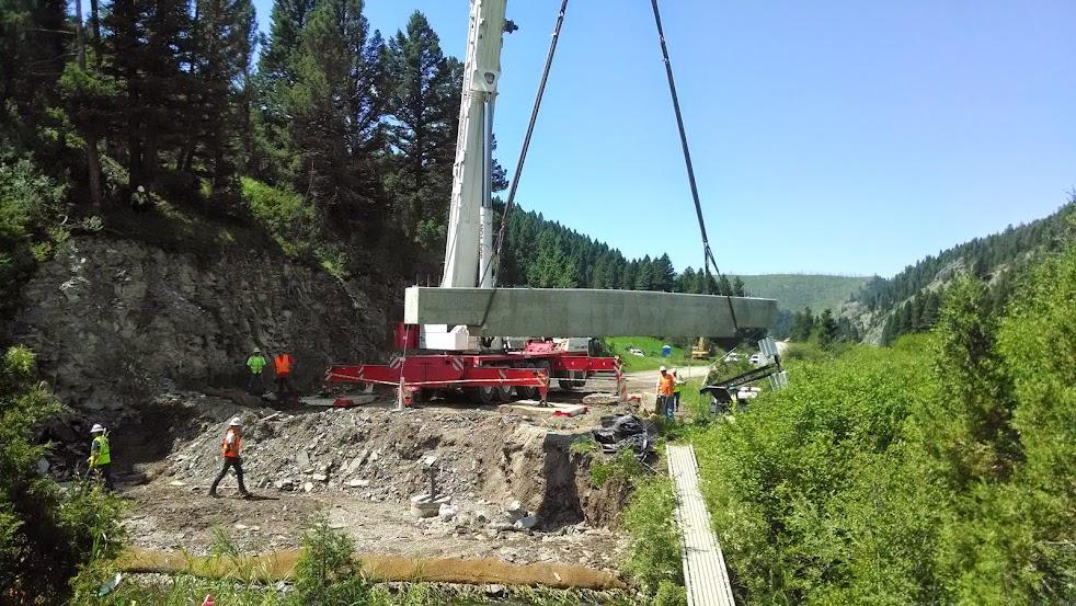 crane carrying bridge beam into place