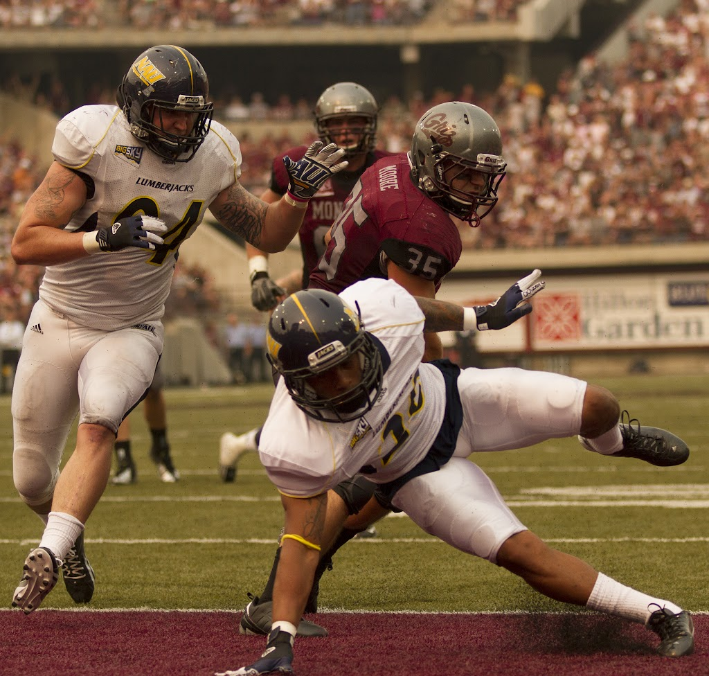 Montana's Dan Moore powers into the endzone early in the 2nd quarter, trucking his way past NAU's Lucky Dozier to make the score 24-7.  Washington-Grizzly Stadium in Missoula, MT, Sept. 22nd, 2012.