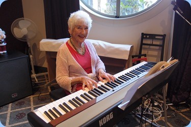 Audrey Henden played the arrival music on a Korg SP-250 digital piano. Photo courtesy of Dennis Lyons.