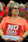 Carole Onaseh from Portland, Ore., attends the first of three public hearings at the Cowlitz County Regional Event Center in Longview, Wash., on May 24, 2016, concerning the proposed Millennium Bulk Terminals coal export terminal. (Photo by: Alex Milan Tracy)