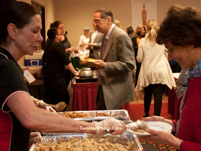 Karen Merchant of Muscle Maker Grill serving up some healthy portions for Catherine Burns.   Photos by TOM HART/  FREELANCE PHOTOGRAPHER