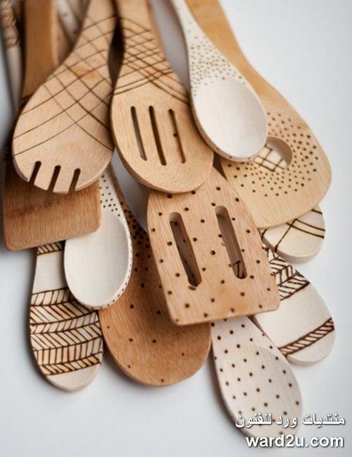 اشغال فنية رائعة على ملاعق خشبية ومعدنية