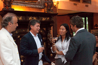 Keiko Fujimori at right the daughter of Peru's former president Alberto Fujimori. Owner of house Leon Temiz, owner of Electronics Expo. far right. 7/23/2010 Photos by TOM HART/ FREELANCE PHOTOGRAPHER