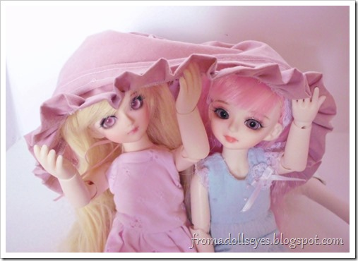Two yosd bjds hiding under clothes.