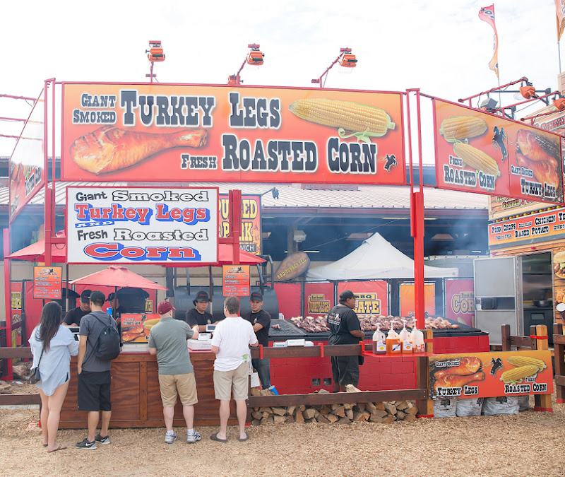 photo of a booth that sells Giant Smoked Turkey Leg