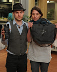 Walter and Margaux Kent holding a small chalkboard tablet and a canvas tote - http://www.etsy.com/shop/PegandAwl