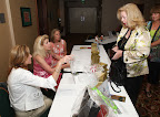 Sally Nees checks in at the Summer Santa luncheon, held recently at the DFW Airport Hyatt Regency. Photo by Mark Rogers