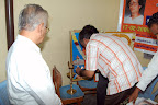 Chief Guest Srinivasan, Exe.Director Reyvish Associates Pvt.Ltd lighting the lamp :: Date: Feb 17, 2008, 10:43 AMNumber of Comments on Photo:0View Photo