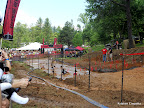 The last obstacle leading to the finish line: another barbed wire crawl through mud and water!