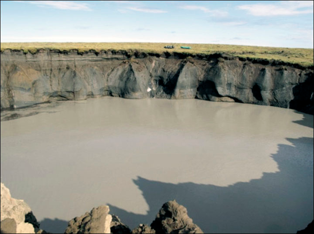 The Taimyr crater, in Siberia, a year and a half after it was found in 2013. The crater was first seen by reindeer herders who almost fell into it soon after the 2013 eruption. Since the crater was formed in a 2013 blowout, its size rapidly increased at least 15 times during the next year and a half. Photo: The Siberian Times