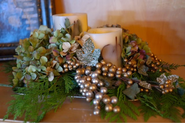 christmas greenery arrangement with candles