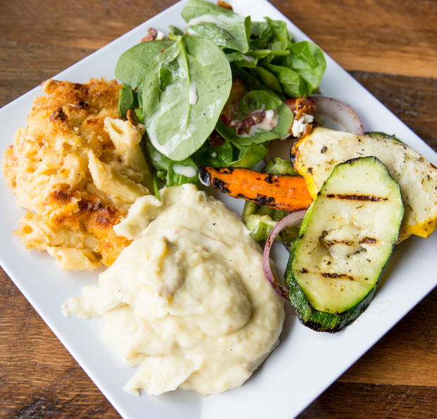 overhead photo of Garlic mashed potatoes with mac n cheese and grilled vegetables, salad