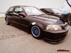 Black EK Civic with blue mesh wheels