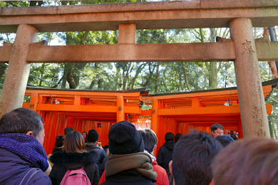 Beginning of the thousands of Torii Gates at Fushimi Inari shrine, which shortly will turn into with two dense, parallel rows of gates called Senbon Torii (thousands of torii gates)