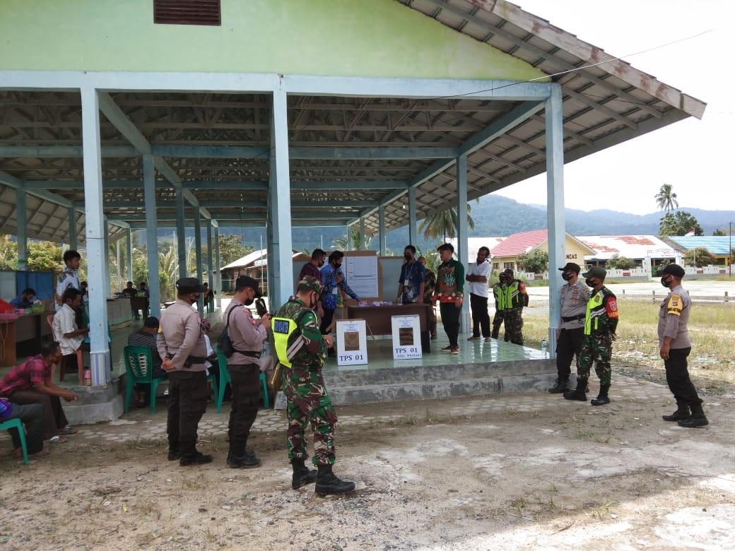 Koramil 1004-07/Pulau Laut Timur Kawal Jalannya Pemilihan Kepala Desa (Kades) Desa Berangas