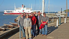 St Francis YC team racing sailing team enjoying sunny day at Cowes in front of Royal Yacht Squadron