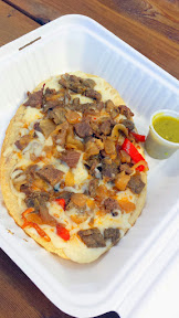 Las Adelas Mexican Comfort Food at Portland Mercado offering of Huarache de Cecina (an oval fried masa patty with salted beef and mushrooms, bell pepper, onion, cheese, and green or red salsa)