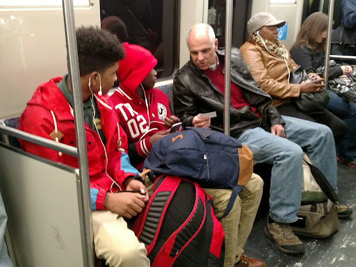 """The gospel transcends race and age. These African-American young men were GLUED to what """"old man"""" Eric had to say. The one on the left was very concerned that he deserved to be sent to Hell, and listened as Eric shared the great news of the gospel of Jesus Christ!"""