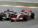 Sebastian Vettel, Toro Rosso STR2 and Fernando Alonso, McLaren MP4