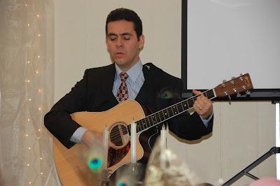 """Pastor Juan singing """"10,000 Reasons"""" by Matt Redmond."""