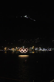 Olympic rings on Vancouver harbour with Cypress Mountain in the background