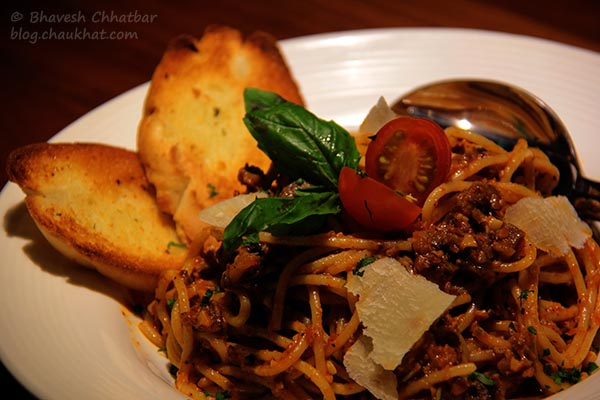 Close-up of Bolognese Bliss Spaghetti served at Toss Sports Lounge Koregaon Park