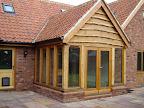 Direct glazed softwood windows in Green Oak garden room