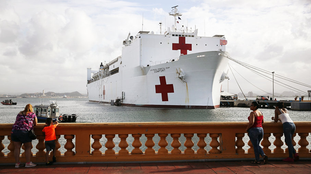 The U.S. Naval Hospital Ship Comfort is seen in the Port of San Juan as it arrives to help after Hurricane Maria swept through the island on 3 October 2017 in San Juan, Puerto Rico. Photo: JOE RAEDLE/GETTY IMAGES
