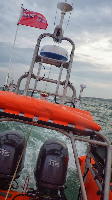 View from the ILB as it tows a 23ft yacht - 28 September 2013. Photo credit: RNLI / Rob Inett